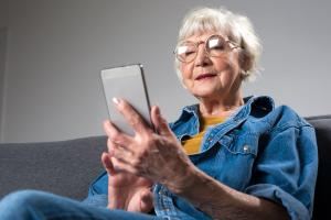 Woman seated with smartphone