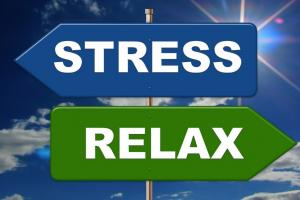 "Signpost positing opposite directions labeled ""stress"" and ""relax"""